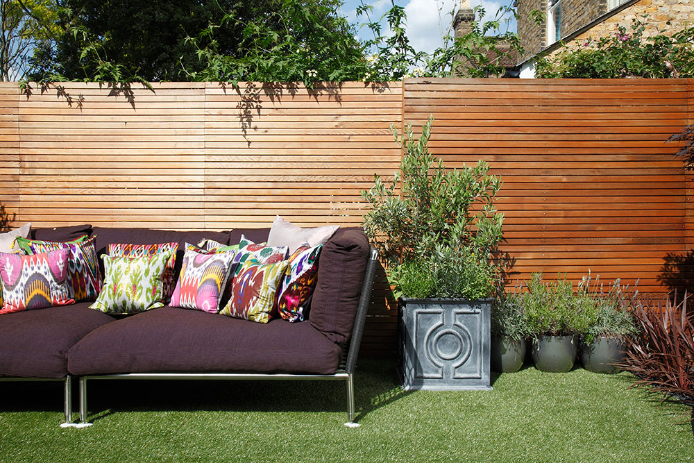 Even the garden gets in on the act with this purple sofa.